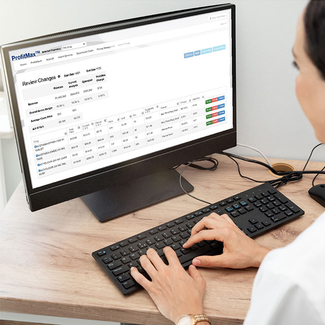 pharmacist looking at profitmax dashboard on computer