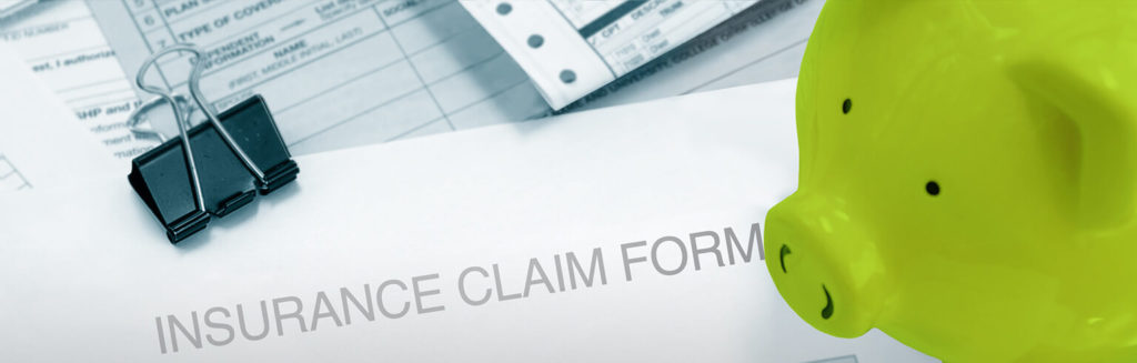 image of medical claim form and green piggy bank