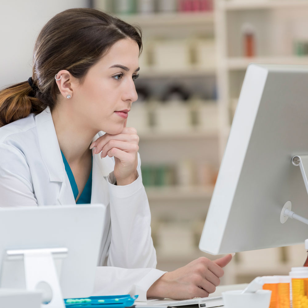 female pharmacist looking at computer